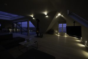 lounge area at night in The Penthouse