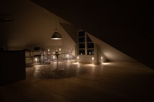 dining area at night at The Penthouse