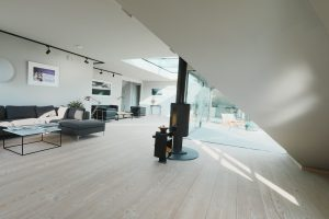 lounge and log burner in The Penthouse