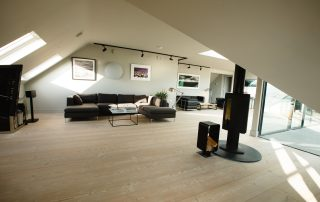 lounge area with log burner in The Penthouse